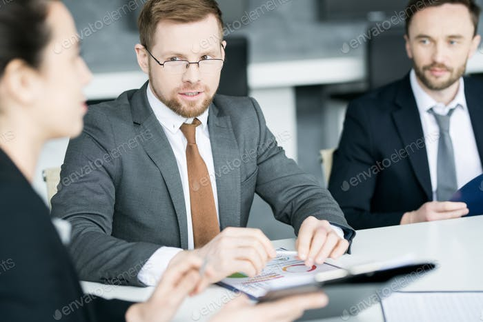 Business People Discussing Strategy in Meeting