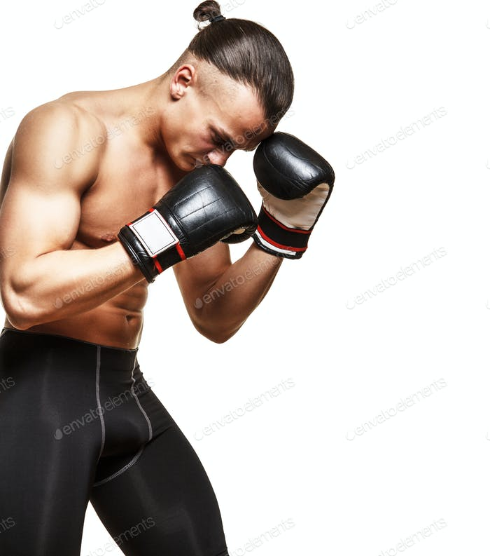 Muscular guy in boxing gloves