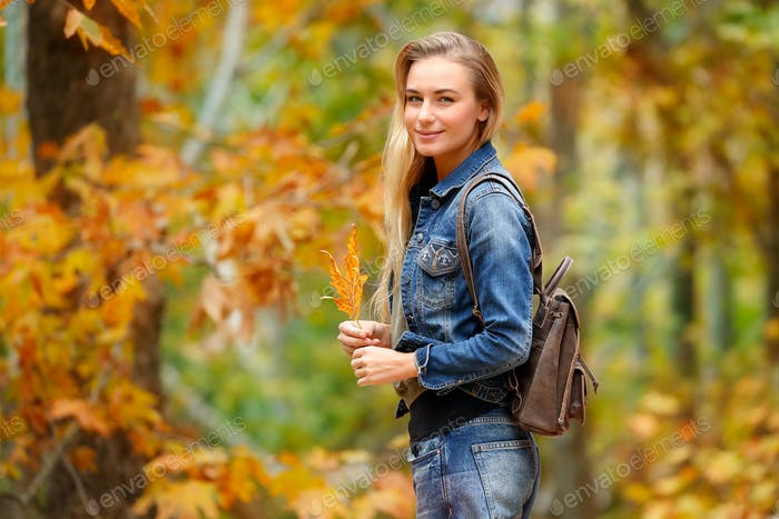 Pretty girl in autumn forest