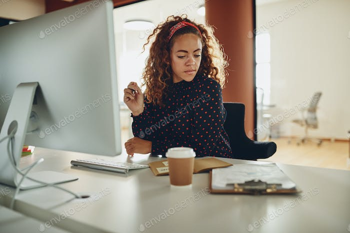 Young businesswoman working on a computer in an office