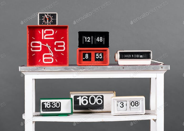 Collection of Retro Clocks on White Table