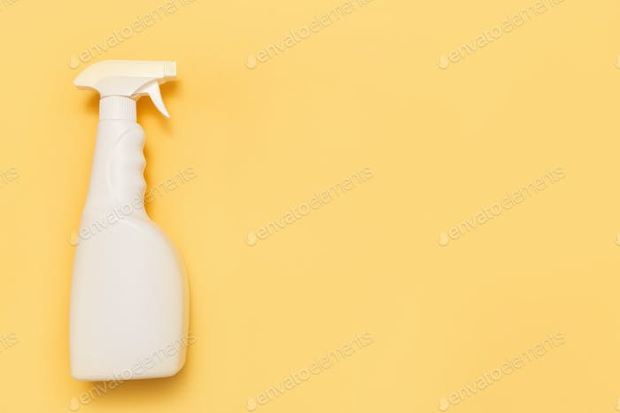 Simple white plastic hand spray bottle on yellow background