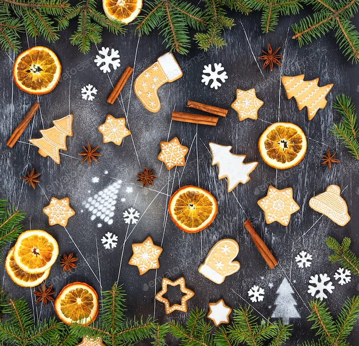 Christmas ginger cookies, dried orange, cinnamon, star anise,  snowflakes and spruce branches