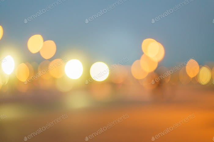 Abstract background with bokeh light of night lights, car headlights, evening lights of big city