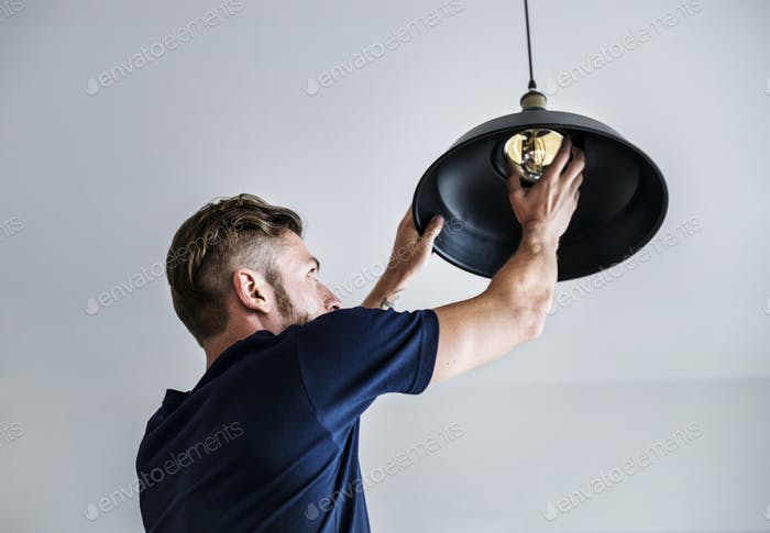 Man changing lightbulb