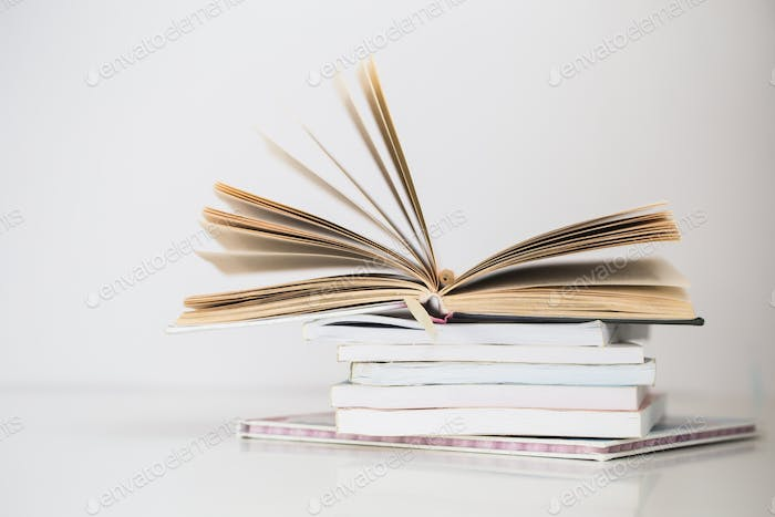 Stack of various books on a white background