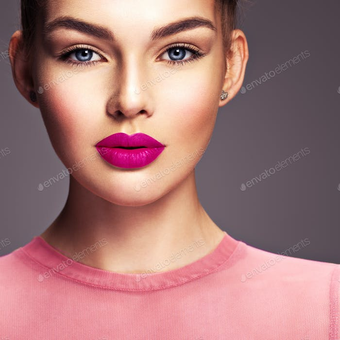 Young woman with fashionable and stylish makeup.