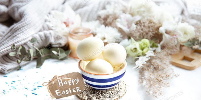 Happy Easter composition with eggs on light blurred background.