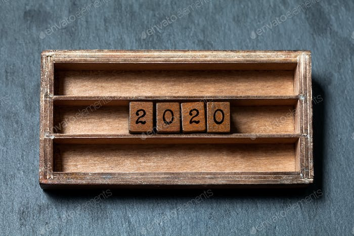 2020 new year retro style card. Two thousand and twentieth year number, wooden cubes in box shelf