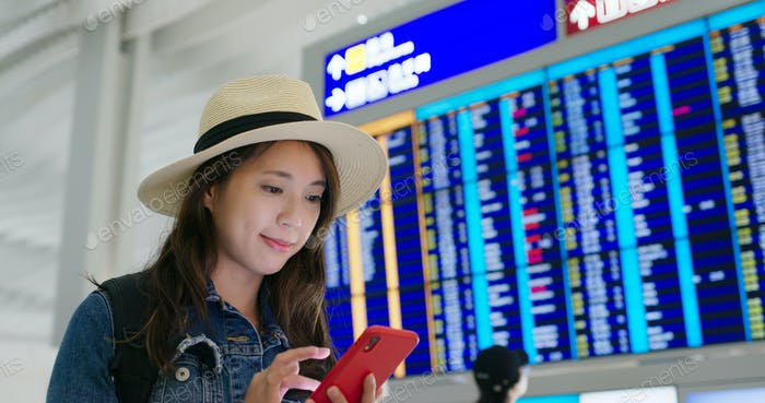 Woman use of mobile phone in the airport