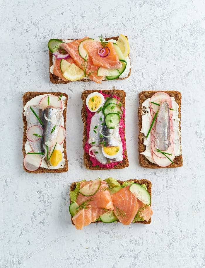Savory fish smorrebrod, set of five traditional Danish sandwiches.