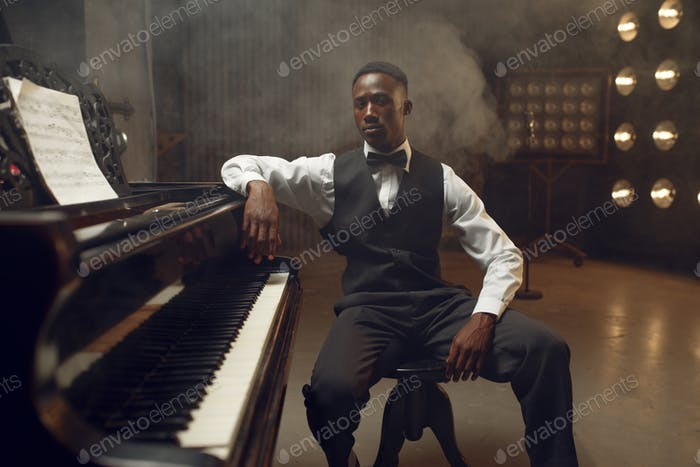 Ebony grand piano player, jazz performer