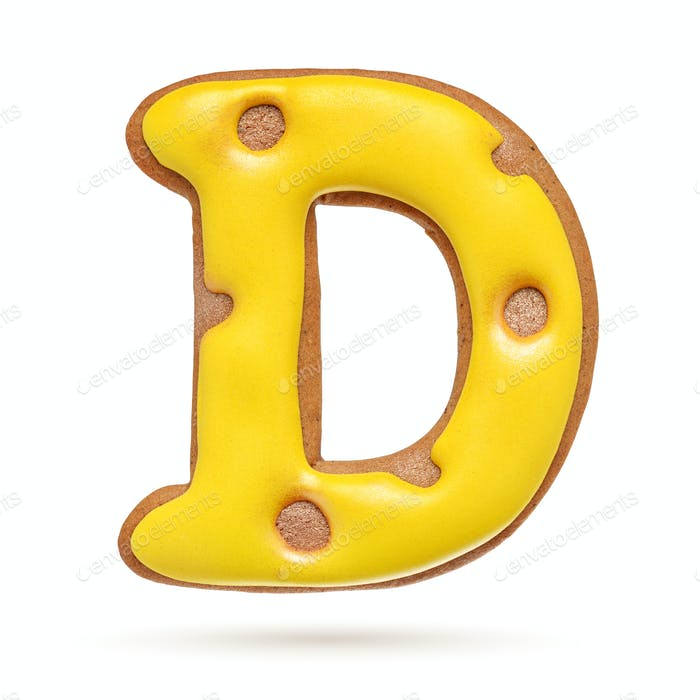 Capital letter D yellow gingerbread biscuit isolated on white.