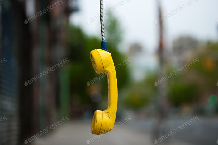 Streets of New York City. USA. An abandoned telephone receiver.