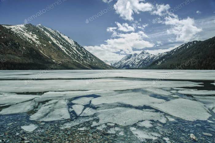 Multinskoe lake with ice in Altai mountains, Russia