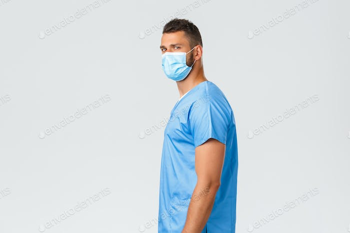 Healthcare workers, covid-19, coronavirus and preventing virus concept. Confident handsome doctor