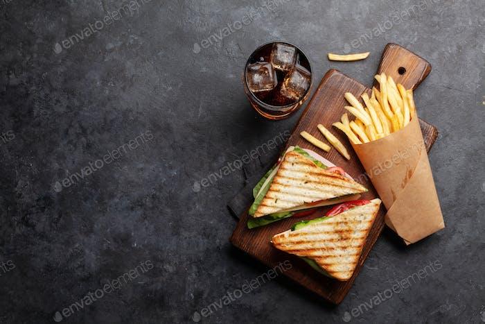 Club sandwich, potato fries and cola