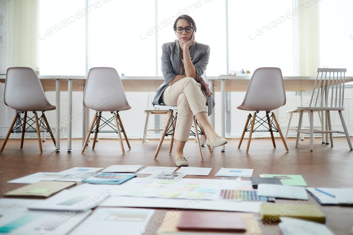 Businesswoman Planning Project in Empty Office