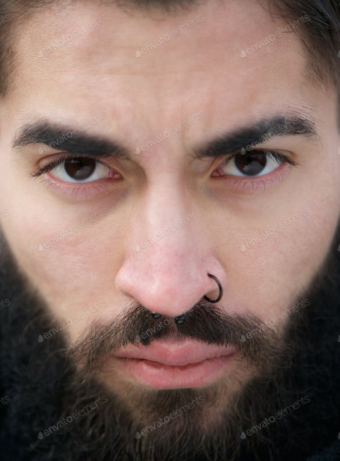 Man face with beard and nose piercing