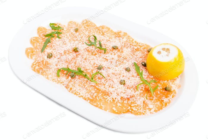 Appetizing salmon carpaccio with arugula.