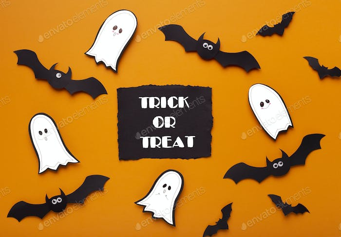 Spelling ghosts and bats asking many sweets and candies