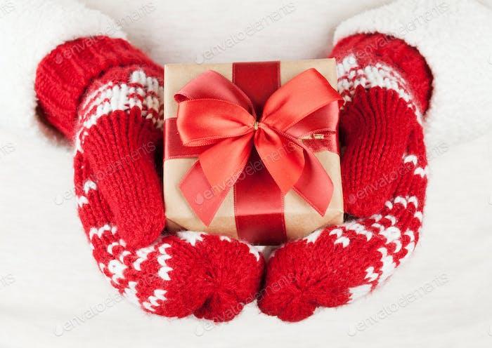 Female hands holding christmas gift