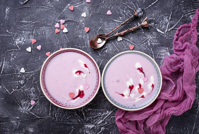 Sweet berry smoothies in bowls. Healthy dessert