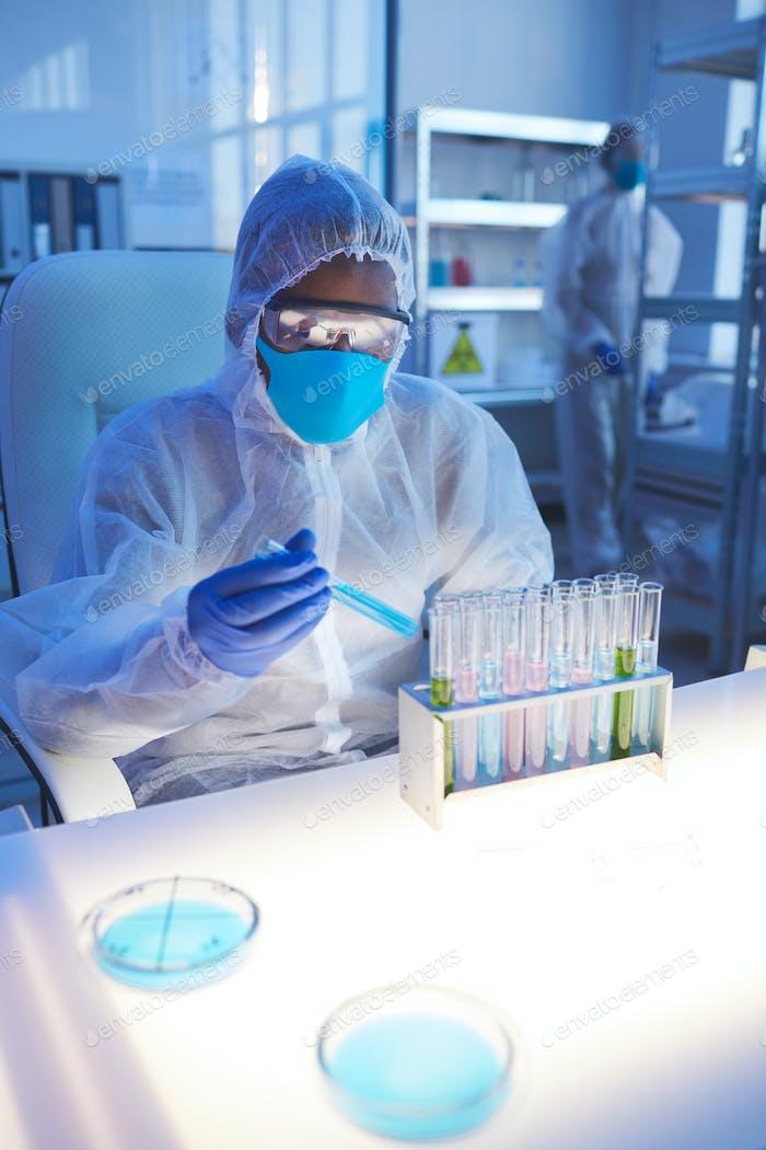 Medical Scientist With Virus Specimen