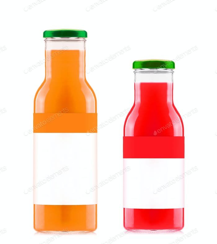 Orange and strawberry juices in glass bottles