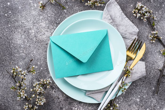 Spring table setting with envelope