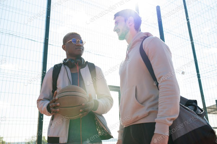 Two Young Men in Outdoor  Basketball Court