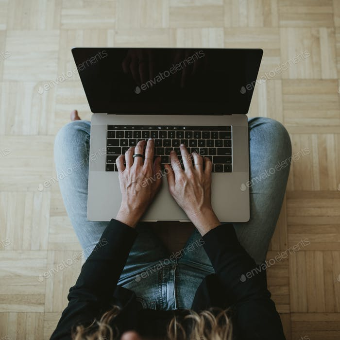 Woman using a laptop while working at home during the coronavirus outbreak