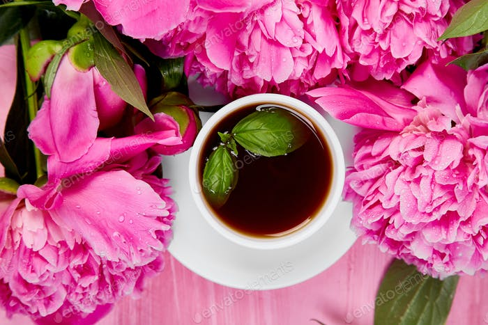 Bouquet Peony flowers and  cup of coffee