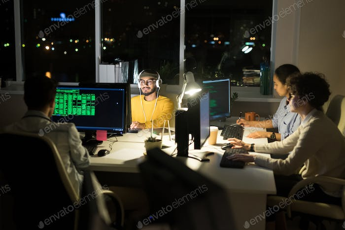 Group of Computer Programmers Coding at Night