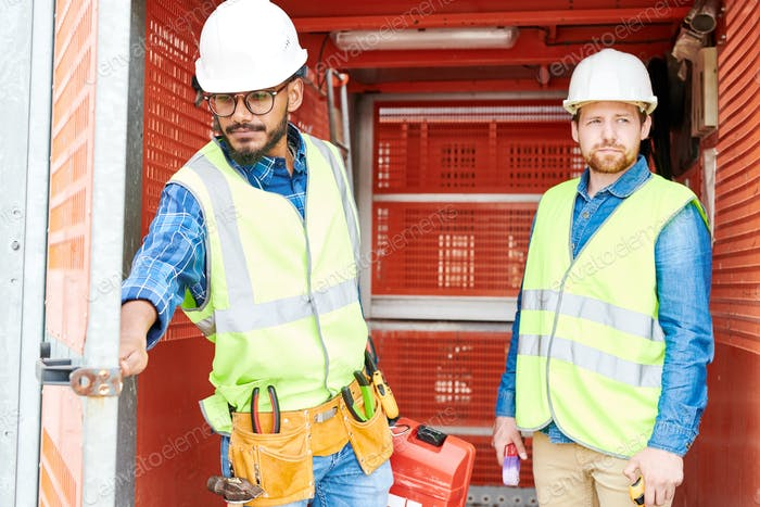 Construction engineers in industrial elevator