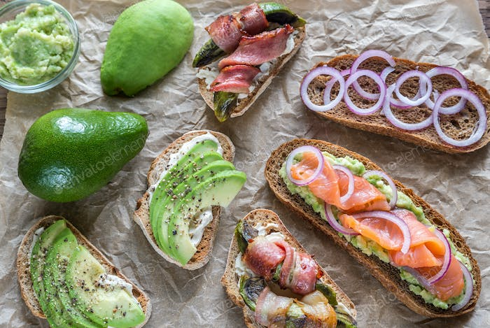 Toasts with avocado and different toppings