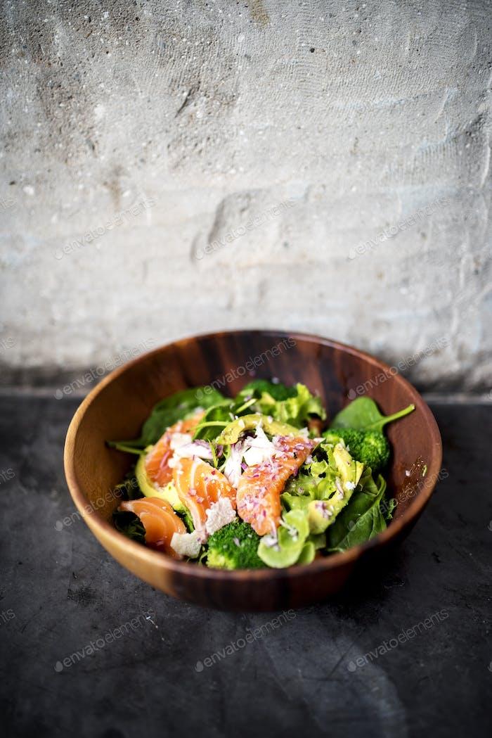 Avocado salmon salad healthy food in rustic style