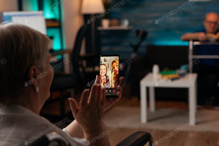 Grandmother talking to family on internet video call