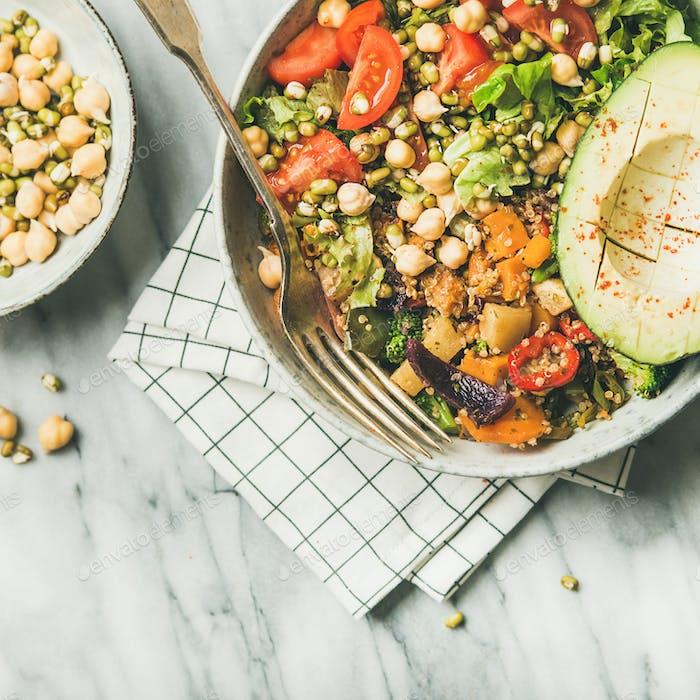 Vegan dinner bowl with avocado, grains, beans, vegetables, square crop