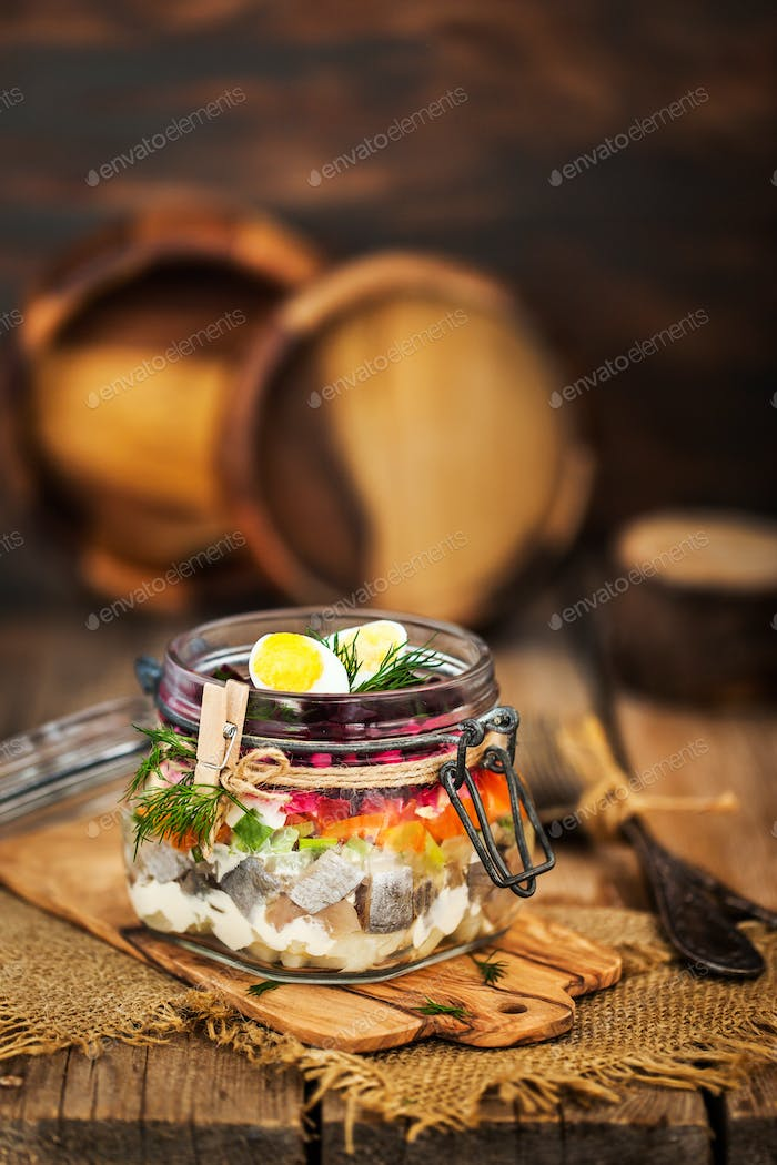 Traditional Russian layered betroot and herring salad (under a f