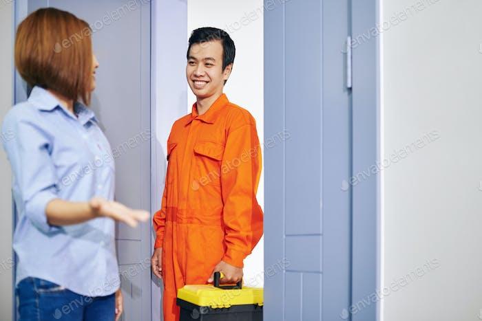 Plumber entering apartment