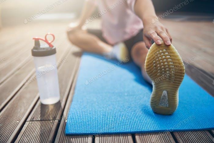 Female spending time outside on yoga mat