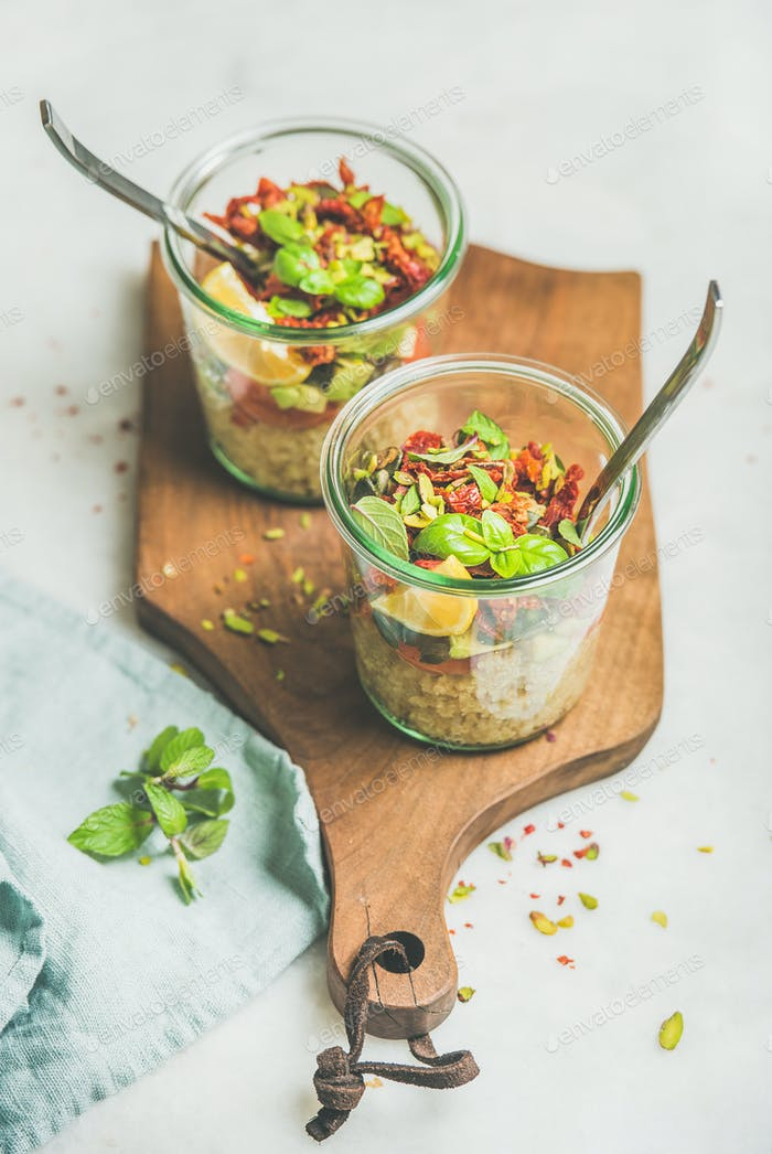 Healthy salad with quionoa, avocado, dried tomatoes and mint