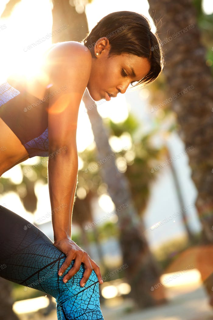 Beautiful african american sporty woman resting outside