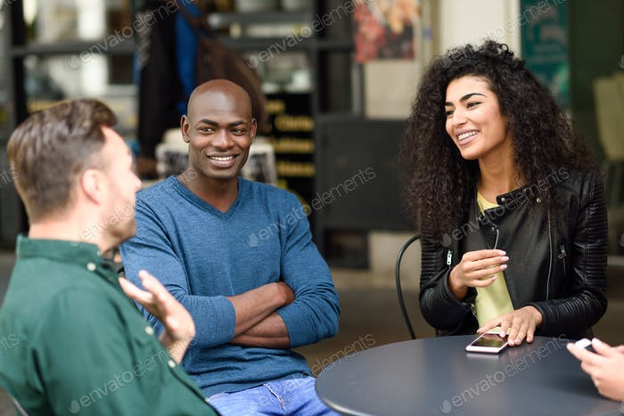 Multiracial group of friends waiting for a coffee together
