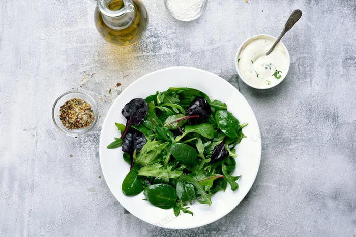 Spring salad with green leaves of spinach, arugul