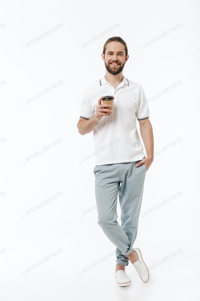 Man walking isolated listening music with earphones drinking coffee.