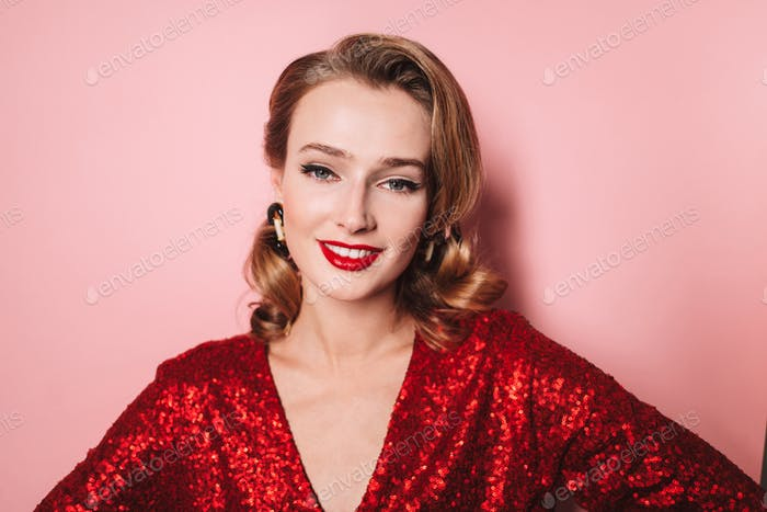 Young beautiful smiling woman with wavy hairstyle and red lips i