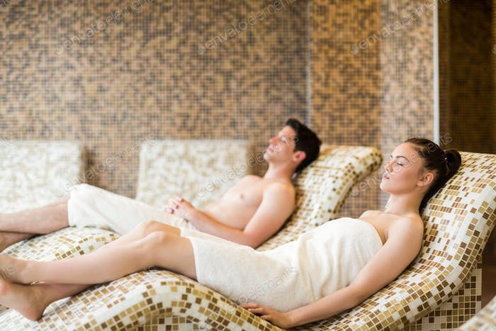 Couple relaxing in the thermal suite at the spa