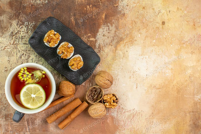 top view cup of tea with cinnamon and confitures on light desk candy photo tea